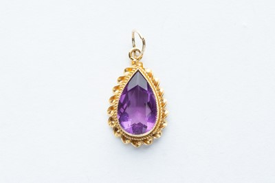 Lot 1 - A 9ct Yellow Gold Pear Cut  Amethyst Pendant