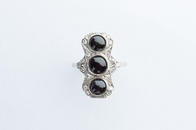 Lot 4 - A Platinum Diamond & Onyx Ring