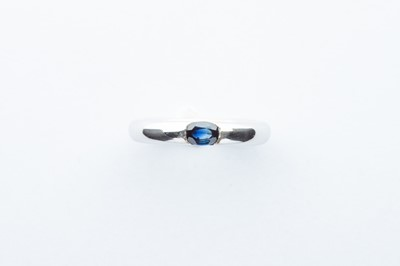 Lot 7 - A Cartier 18ct White Gold & Blue Oval Sapphire Ring