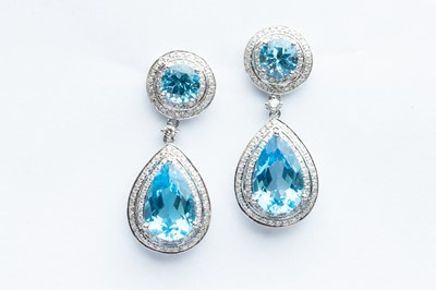 Lot 21 - A Pair of 14ct White Gold Blue Topaz & Diamond Drop Earrings