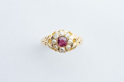 Lot 25 - A 18ct Yellow Gold Ruby & Diamond Cluster Ring