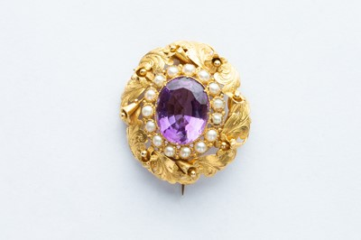 Lot 32 - A 18ct Yellow Gold Amethyst & Seed Pearl Floral Brooch