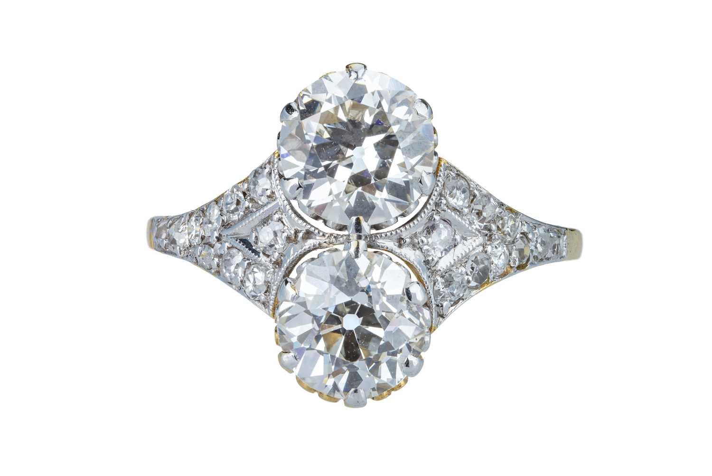 Lot 2 - An elegant Art Deco two stone diamond ring.