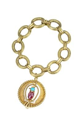 Lot 83 - MELLERIO. An 18 ct gold bracelet with gem set bird charm.