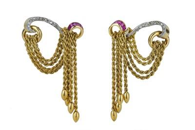 Lot 82 - MELLERIO. A pair of 1940s ruby and diamond tassel earrings.
