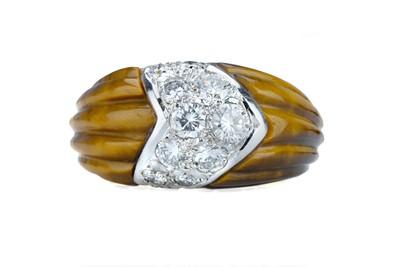 Lot 88 - BEN ROSENFELD. A 1950s tigers eye and diamond ring.