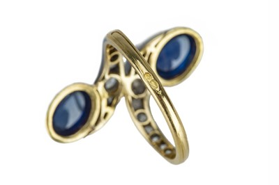 Lot 3 - An elegant early 20th century French cabochon sapphire and diamond ring.