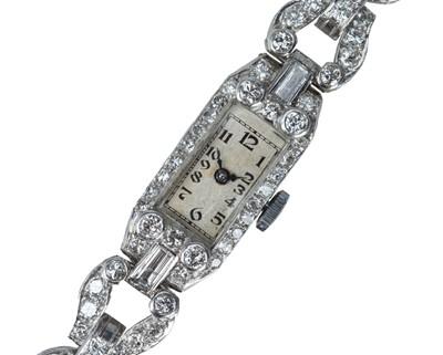 Lot 65 - An Art Deco platinum and diamond cocktail watch.