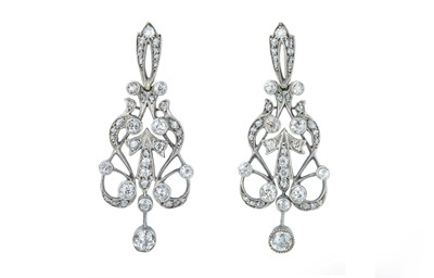 Lot 36 - An elegant pair of late Victorian diamond earrings.