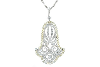 Lot 77 - A delicate Art Deco diamond and seed pearl pendant.