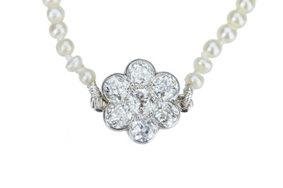 Lot 75 - An early 20th century natural pearl necklace.
