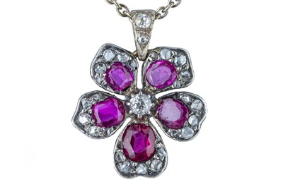 Lot 73 - An early 20th century ruby and diamond flower pendant.