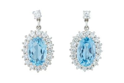 Lot 44 - A pair of aquamarine and diamond earrings.