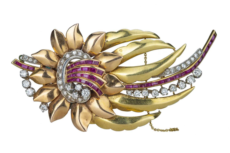 Lot 51 - A mid 20th century ruby and diamond set flower spray brooch.