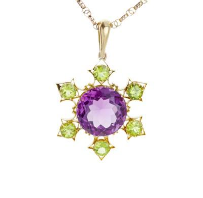 Lot 80 - A striking amethyst and peridot pendant.