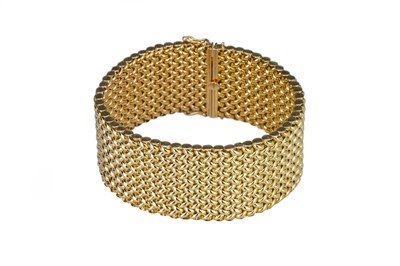 Lot 57 - A bold and heavy gold weave link bracelet.
