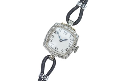 Lot 62 - An Edwardian 18 carat gold and diamond cocktail watch.