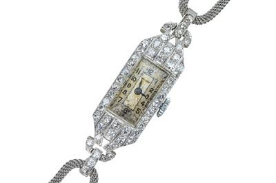 Lot 63 - Unicorn (by ROLEX). A lady's Art Deco diamond cocktail watch.