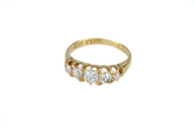 Lot 15 - A Victorian 18 carat gold and diamond five stone ring.
