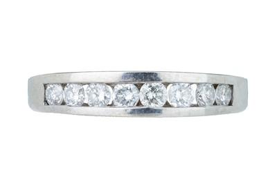 Lot 20 - A diamond half eternity band.