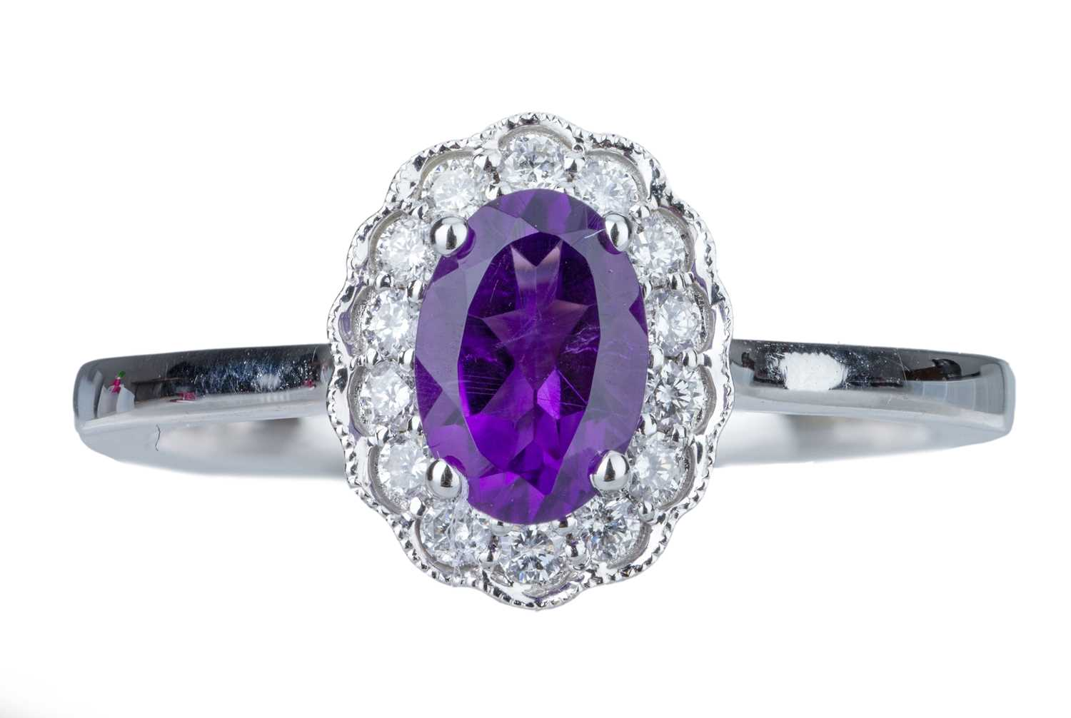 Lot 28 - An amethyst and diamond cluster ring.