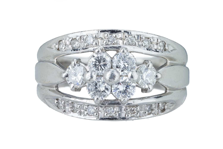 Lot 17 - A delicate diamond ring.