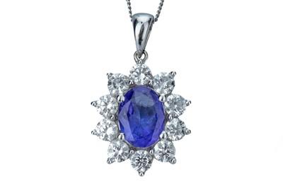 Lot 81 - A tanzanite and diamond pendant.