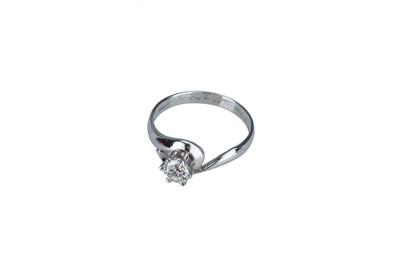 Lot 18 - A single stone diamond ring.