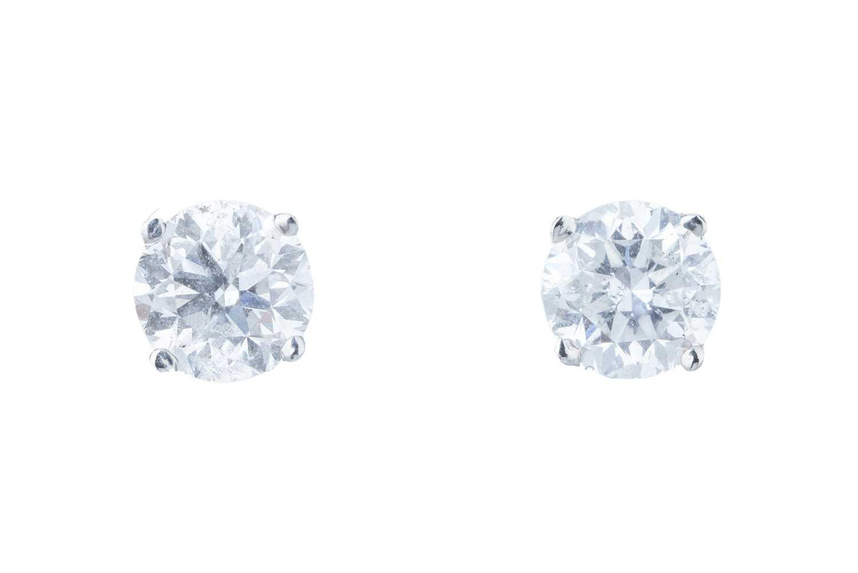 Lot 38 - A pair of diamond ear studs.