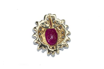 Lot 40 - A pair of ruby and diamond ear studs.