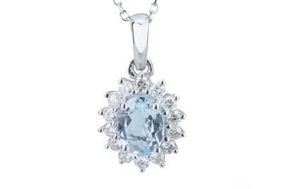 Lot 79 - An aquamarine and diamond pendant.