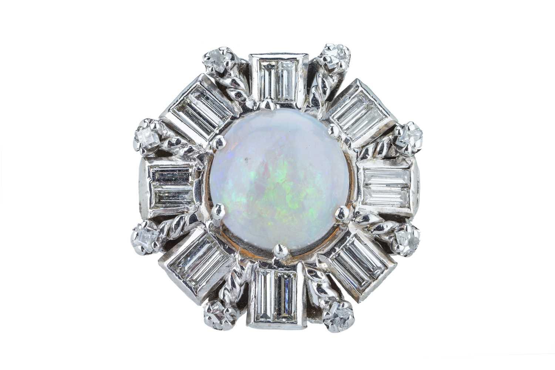 Lot 31 - A precious opal and diamond dress ring.