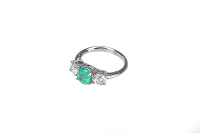 Lot 8 - An emerald and diamond ring.