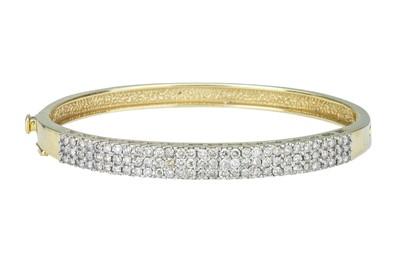 Lot 56 - A diamond bangle.