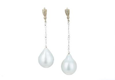 Lot 42 - A pair of asymmetrical baroque pearl earrings.