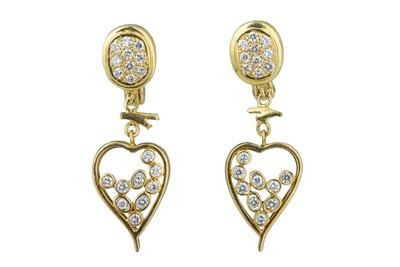 Lot 41 - A pair of diamond earrings.