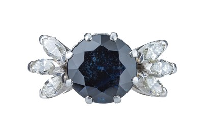 Lot 27 - A sapphire and diamond ring.