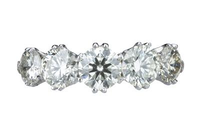 Lot 92 - A five stone diamond ring.