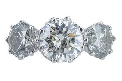 Lot 94 - An impressive three stone diamond ring.