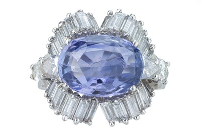 Lot 95 - A sapphire and diamond dress ring.