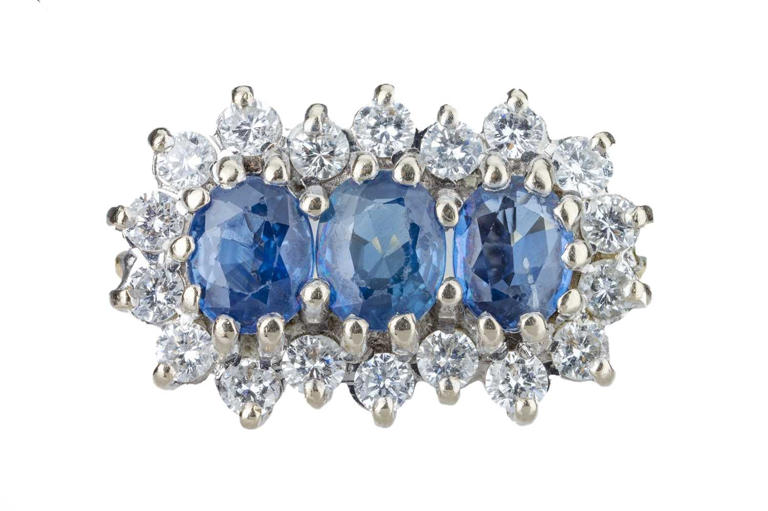 Lot 25 - A sapphire and diamond ring.