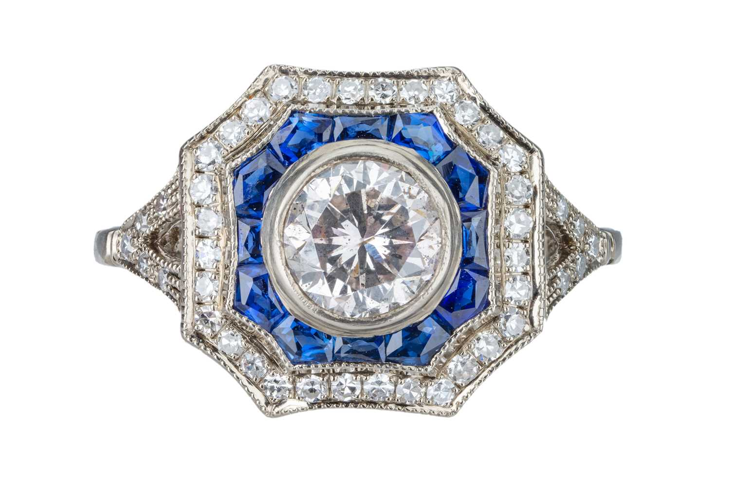 Lot 4 - An Art Deco diamond and sapphire target cluster ring.