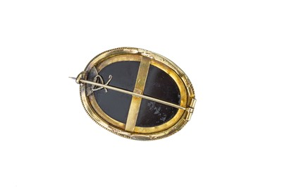 Lot 49 - A Victorian diamond and onyx brooch.