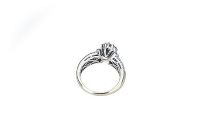 Lot 23 - A diamond dress ring.