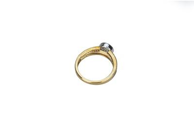 Lot 24 - A illusion set diamond ring.