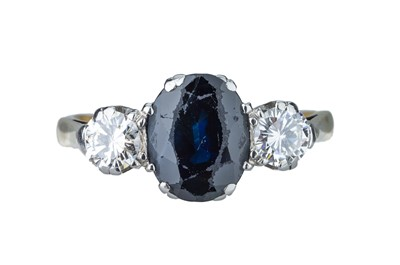 Lot 26 - A sapphire and diamond ring.